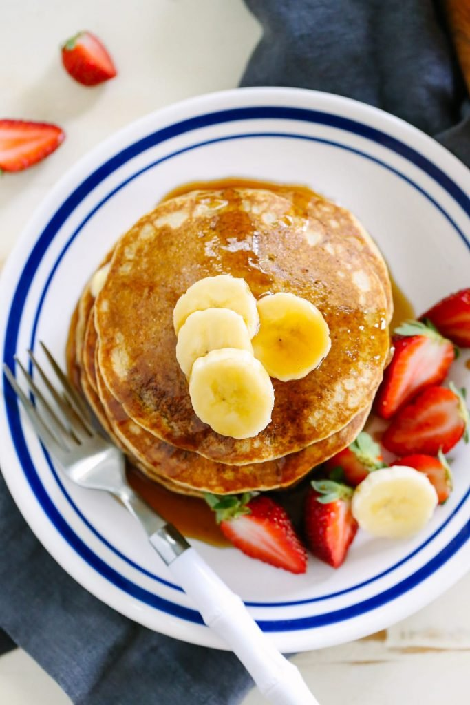 From scratch whole wheat pancakes that taste amazing! No boxed ingredients, just healthy real food. Love this. Make in advance and freeze the extras for busy mornings.