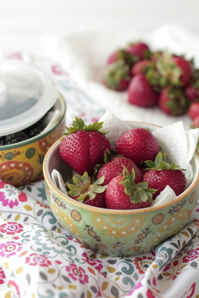 """Don't throw out the berries! Learn """"How to Keep Berries Fresh"""" with a simple photo tutorial. Saves so much money!"""