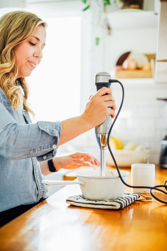 Using an immersion blender to create a latte