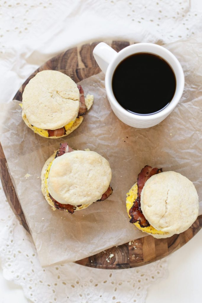 Homemade bacon, egg, and cheese biscuits made with real food! Zero boxed or processed food ingredients. Plus, these sandwiches can be made in advance and frozen for later. The perfect busy breakfast meal.