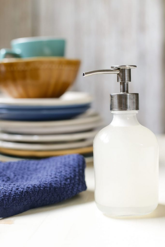 A super easy and effective DIY dish soap recipe! This actually cleans dishes, deodorizes, and cuts grease! Natural, homemade, and easy!