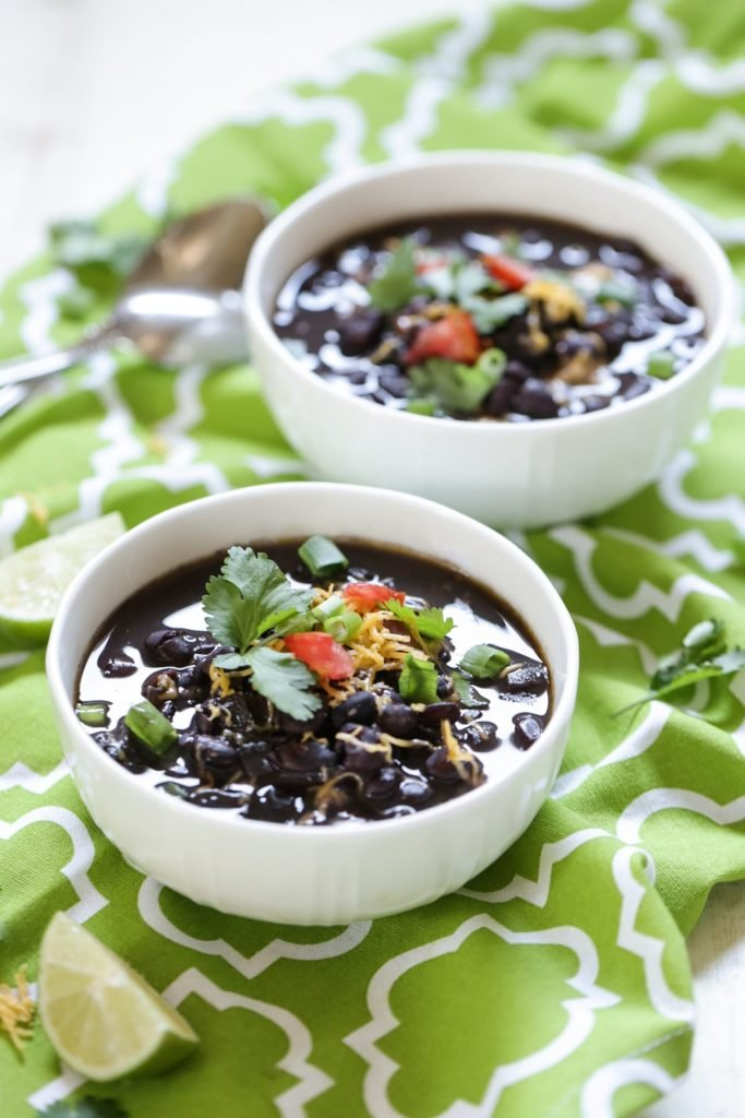 Super easy and so healthy! Just saute and dump in the crock-pot. Hours later delicious homemade black bean soup is ready to be served. I love this recipe. It feeds my family for days and costs just pennies to make.