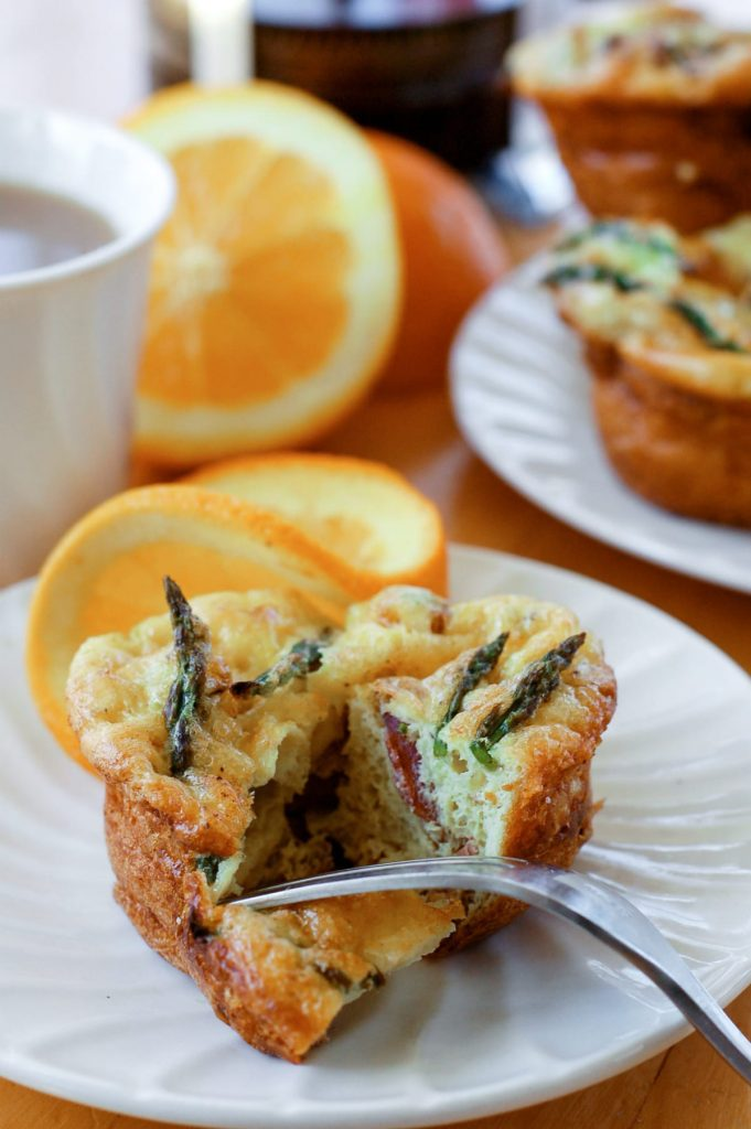 Make-ahead and freezer-friendly mini quiche filled with spring vegetables and bacon! These are so good and packed with nutrient-rich ingredients. Budget-friendly, too!