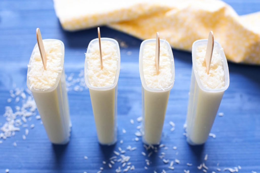 Pina Colada Popsicles. Only TWO ingredients! 100% vegan, gluten-free, and dairy-free. No nasty ingredients or sweeteners. Just blend, pour, and enjoy. So easy. Family-friendly.