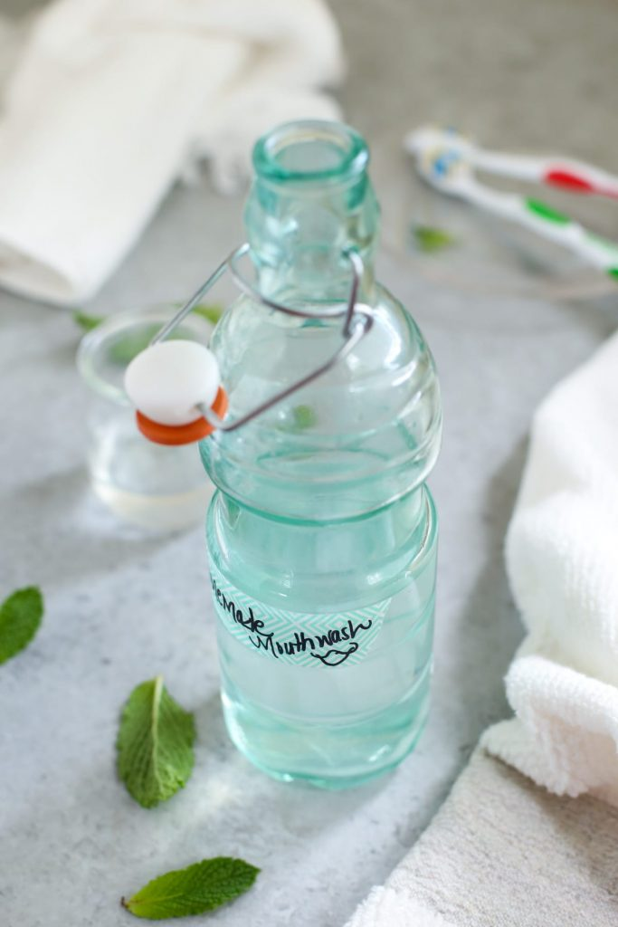 Homemade mouthwash is so easy to make! Get rid of those nasty chemical mouthwashes and grab 5 all natural ingredients for this refreshing mouthwash!
