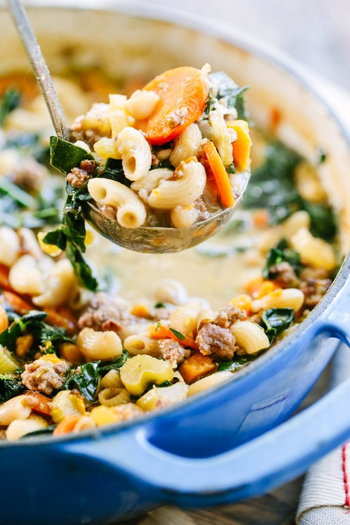 Easy Sausage, Kale, and White Bean Soup. This comforting and hearty soup is made with inexpensive and easily accessible winter ingredients and only takes 40 minutes to make!