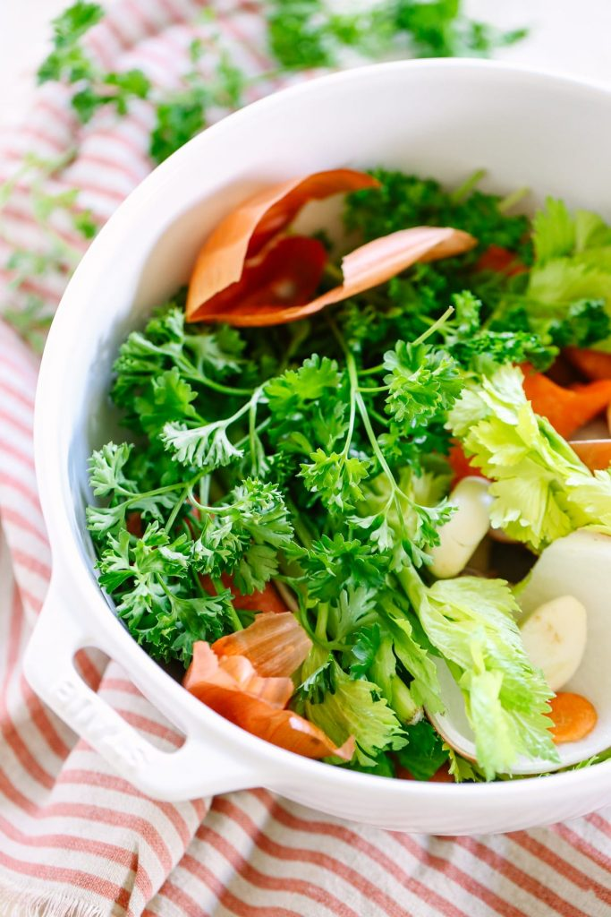 How to Make Homemade Vegetable Broth with Scraps. So easy and cheap to make with the scraps from your weekly veggies!