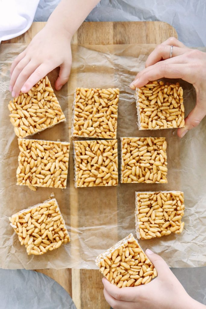 I CAN'T stop eating these crispy rice treats! Sooo good! Plus, they are made with 100% natural ingredients: puffed brown rice, honey, nut butter, butter, and vanilla extract. That's it! No bake, too.