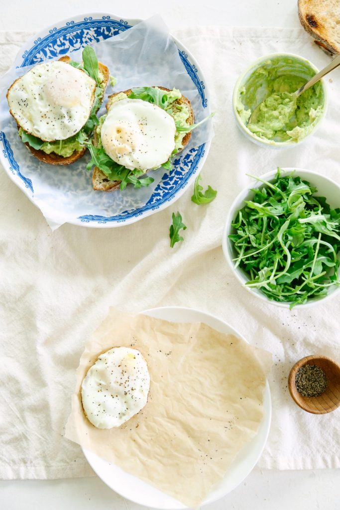 This avocado toast with egg and arugula is amazing! You can play around with herbs and spices to make a different toast each time!