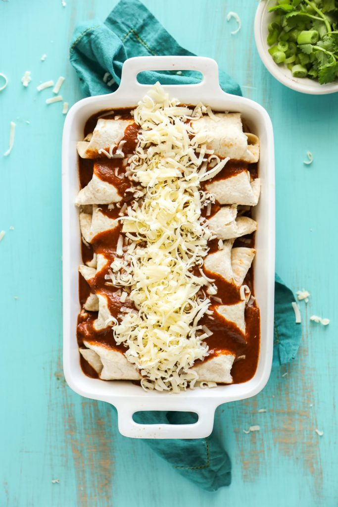 Simple homemade enchiladas made with chicken and cheese, and a homemade enchilada sauce.