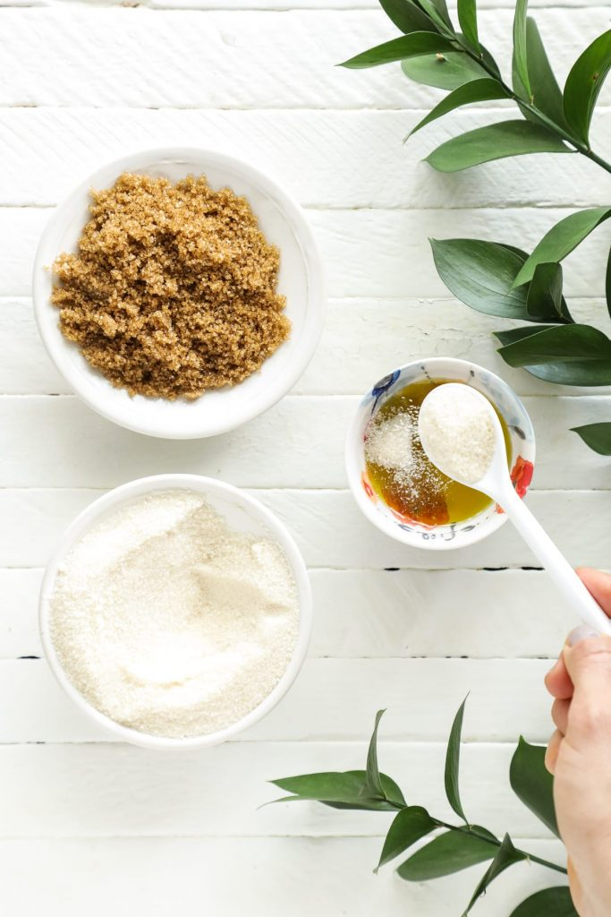 A simple two-ingredient exfoliator scrub made with sugar and oil. Sloughs away dead skin cells and hydrates the skin. Made with kitchen ingredients.