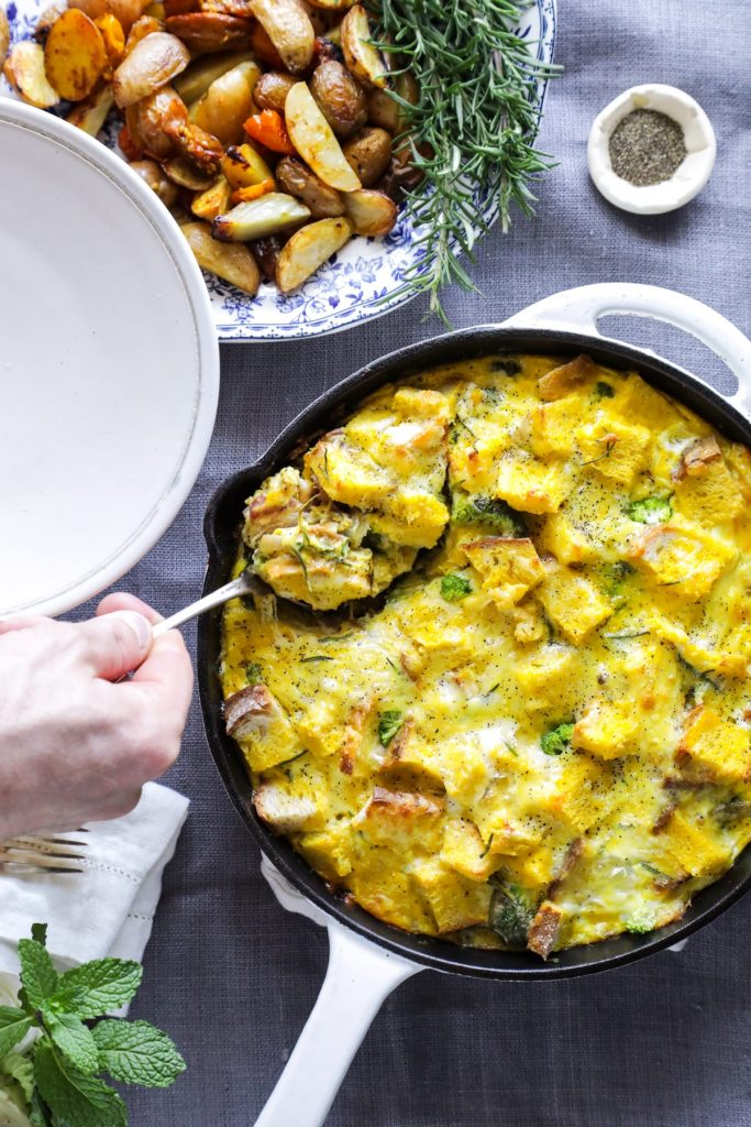 A make-ahead, one-skillet strata (egg and bread casserole) made with veggies and bacon.