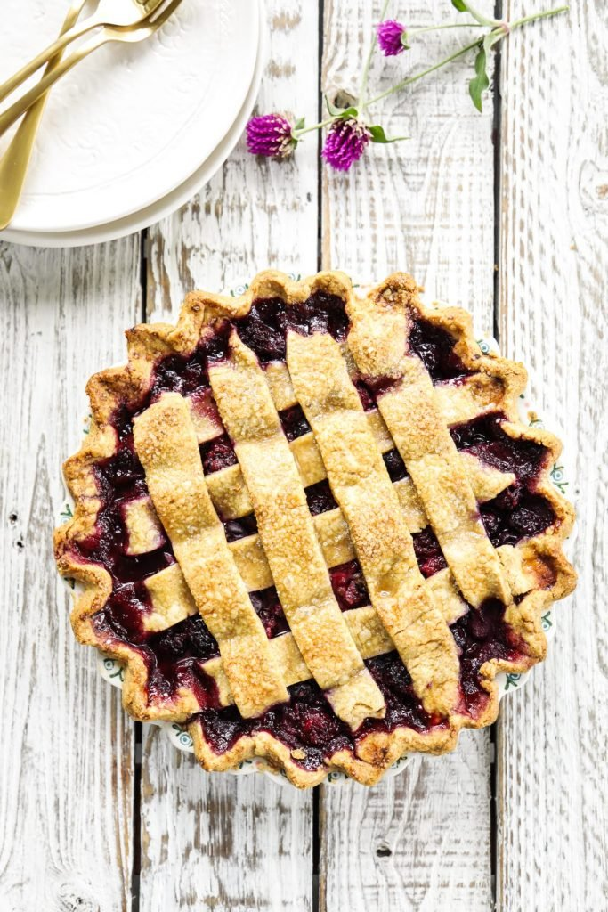 A homemade mixed berry pie featuring frozen (summer) berries and a flaky, homemade crust.