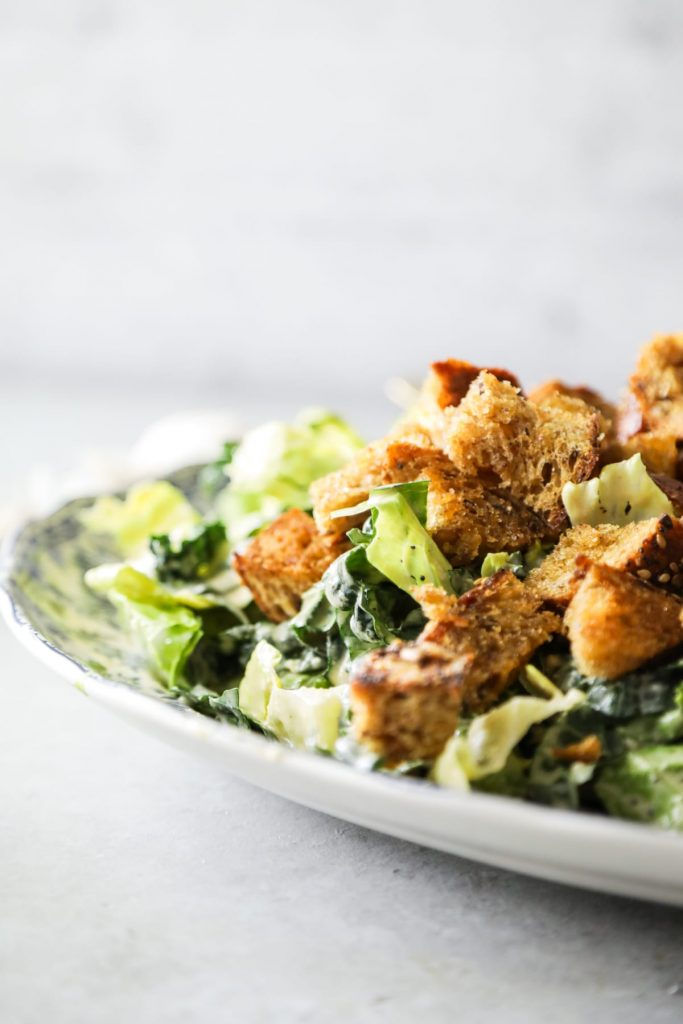 The BEST caesar salad I've ever had! So creamy. Made with real food ingredients. And the salad is super easy to make (including the homemade croutons).
