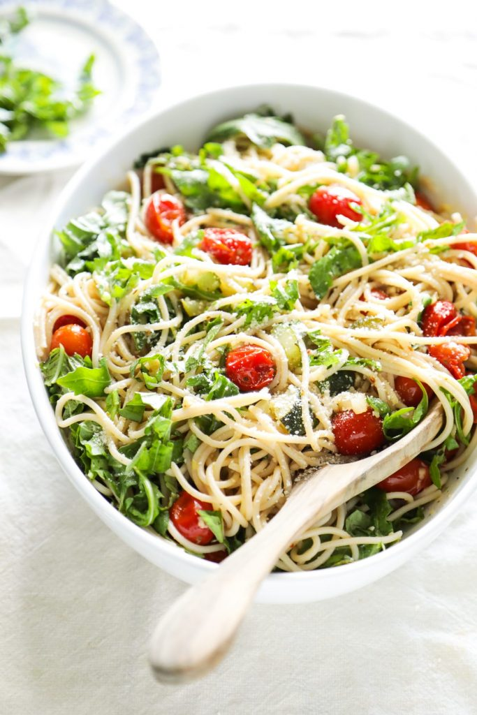 My absolute favorite pasta! This summer pasta with 'burst' tomatoes, zucchini, and arugula is so easy to make. Just cook the veggies and noodles, and mix together.