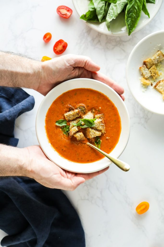 A seasonal fresh tomato soup featuring roasted red pepper, fresh tomatoes, basil, and nourishing broth. So easy and fast!