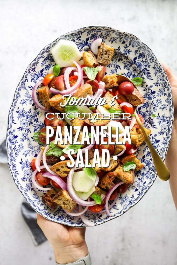 A classic summer panzanella salad made with homemade croutons, grape or cherry tomatoes, cucumbers, red onions, and fresh basil.