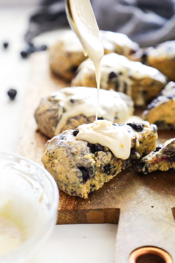 Homemade blueberry scones made with einkorn flour and naturally sweetened with maple syrup. The main sweetness and flavor comes from the lemon glaze, so don't skip it.