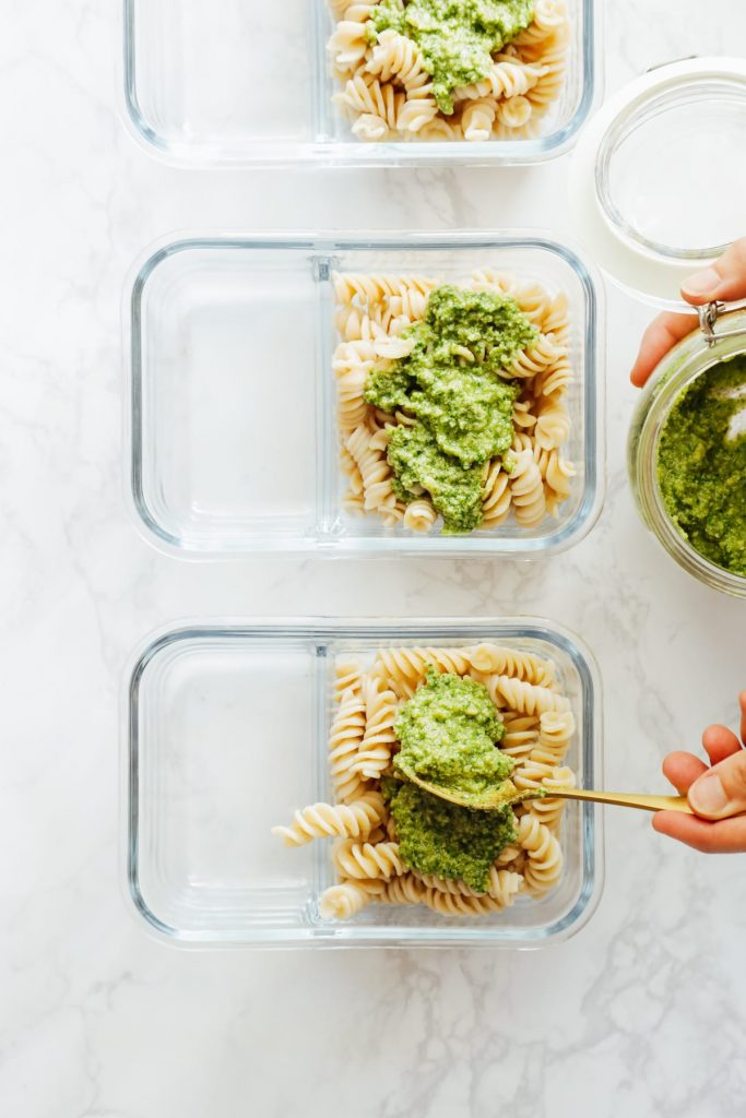 From-scratch pesto is combined with pasta, chicken, and roasted veggies for a make-ahead pasta bowl-style meal. Easy, fresh, real, and make-ahead friendly!