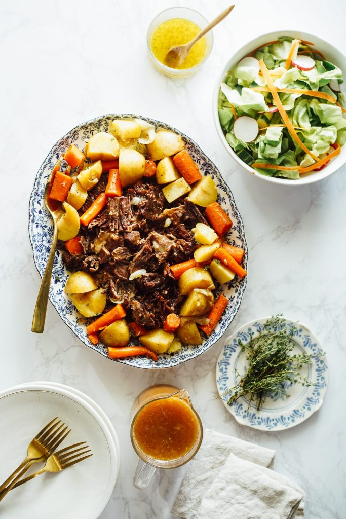 The perfect one-pot roast with root vegetables and homemade gravy, made in the Instant Pot. The best, easiest way to make beef pot roast and veggies.