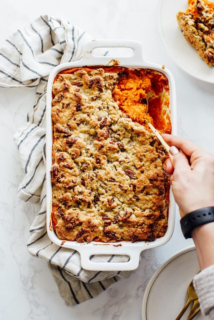 A homemade, real food, naturally-sweetened sweet potato casserole with a gluten-free topping made with almond flour and pecans. Low sugar, maple sweetened.
