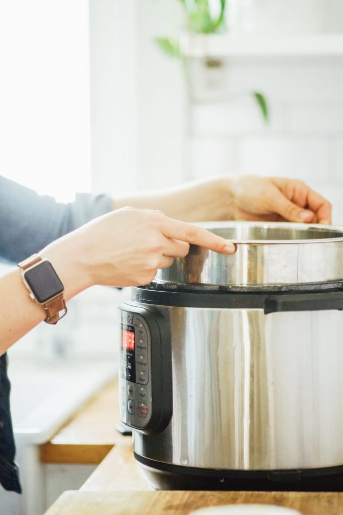 Placing the Instant Pot liner, filled with milk and yogurt stater, in the Instant Pot
