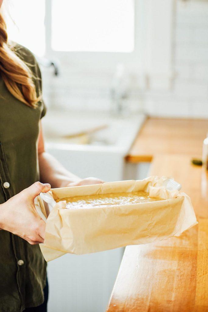 Preparing the almond flour banana bread for the oven