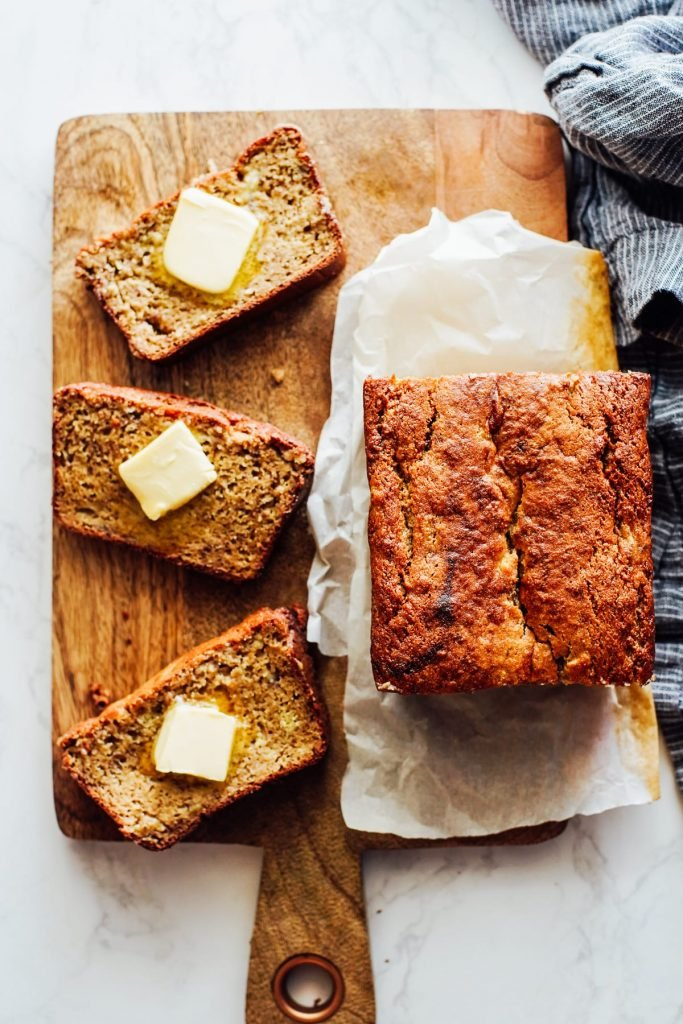 almond flour banana bread sliced with butter