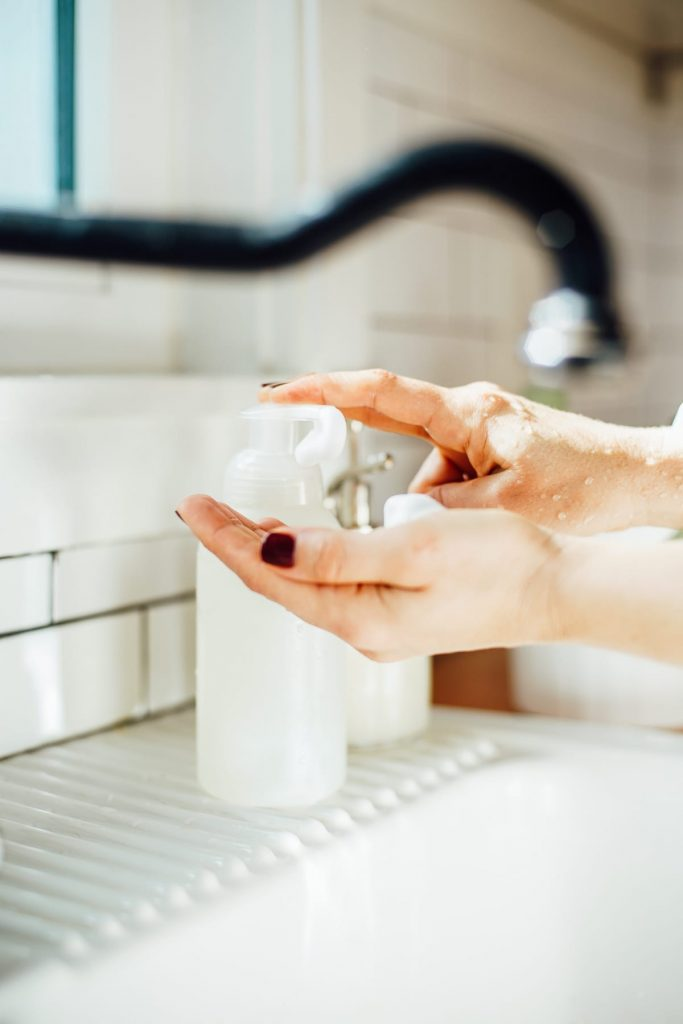 Using the hand soap to wash hands