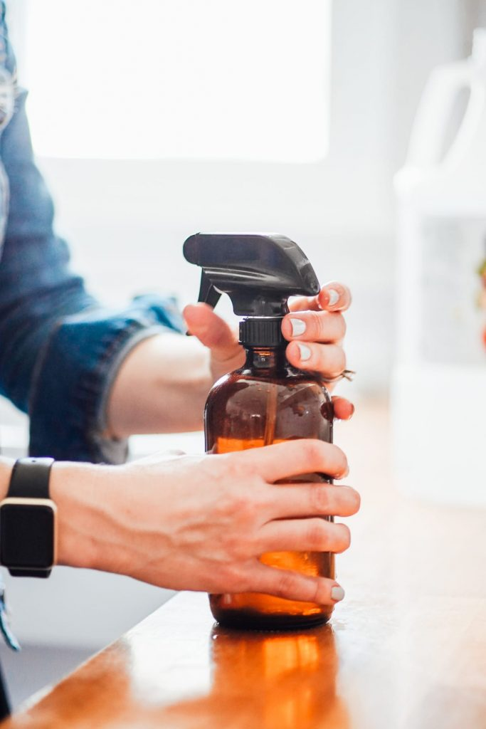 putting top on spray bottle after making all purpose cleaner