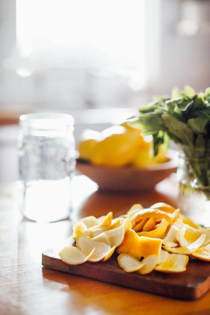 orange peels, herbs, and jar ready to make cleaner