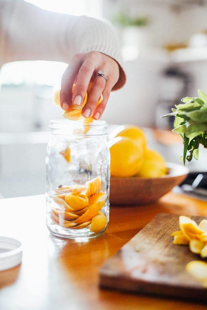 adding orange peels to jar