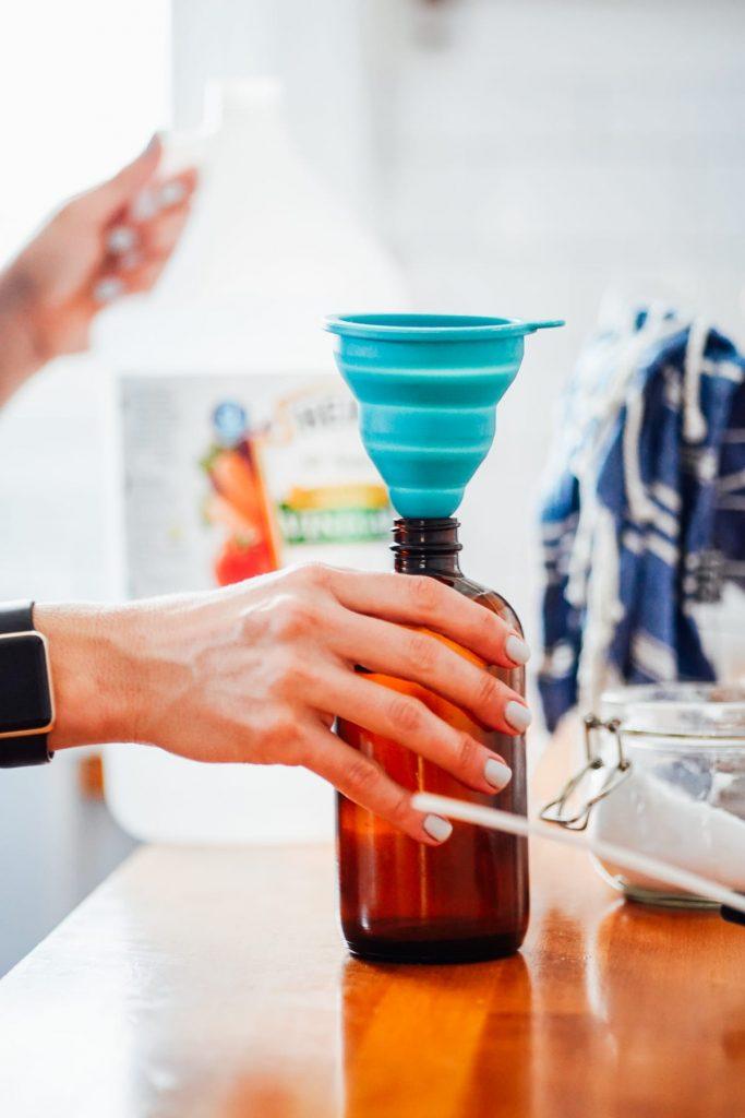 Adding vinegar to spray bottle to make all purpose cleaner