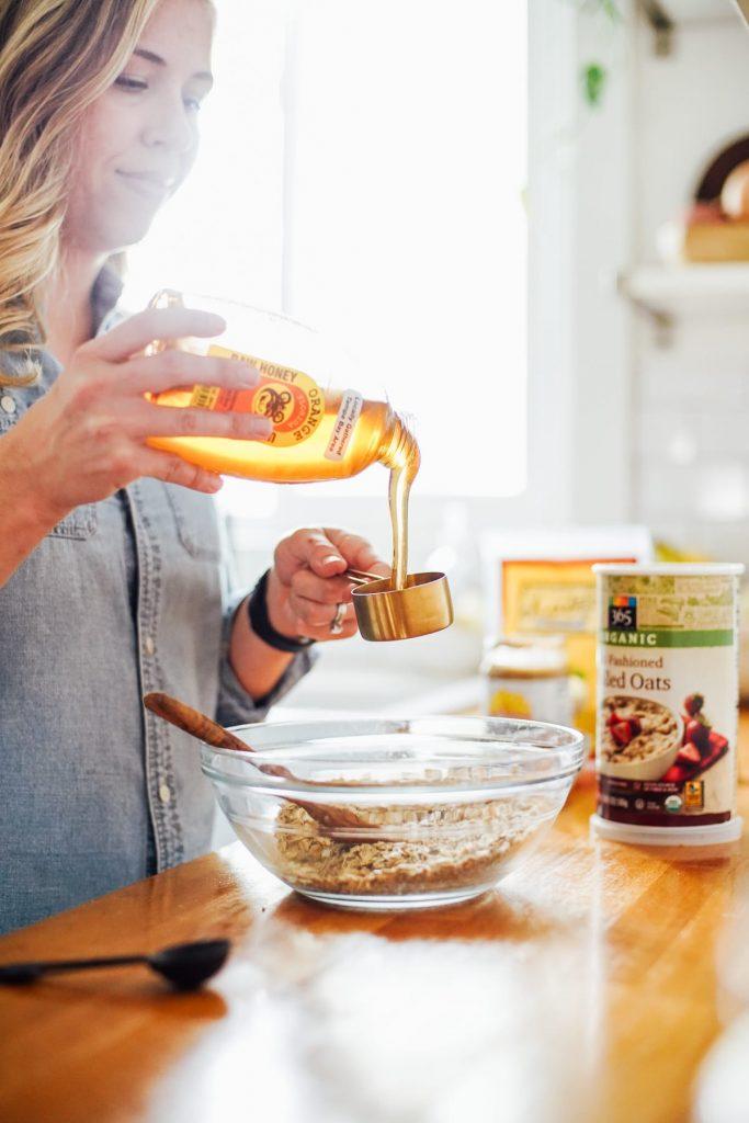 adding honey to the energy bite mixture