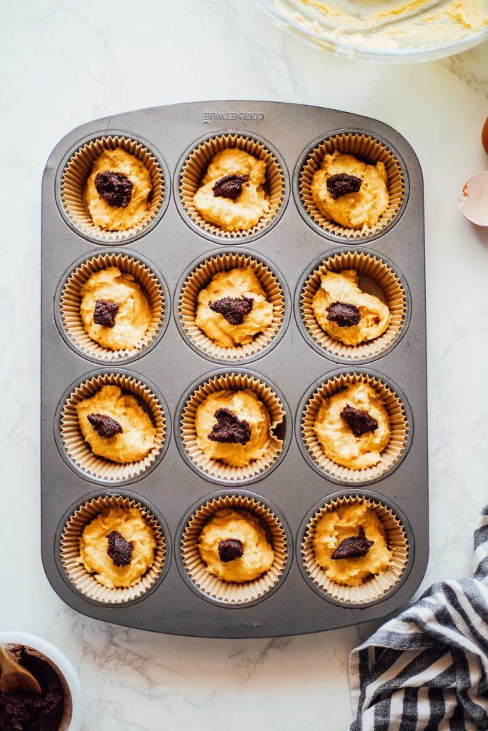 einkorn muffin batter with cinnamon swirl top